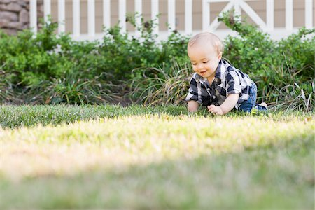 Baby Crawling on Lawn Stock Photo - Rights-Managed, Code: 700-03865382