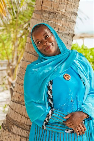 Portrait of Woman Leaning Against Tree, Zanzibar, United Republic of Tanzania, Africa Stock Photo - Rights-Managed, Code: 700-03865392