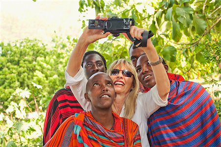 Woman Taking Self-Portrait with Group of Masai Men Stock Photo - Rights-Managed, Code: 700-03865404