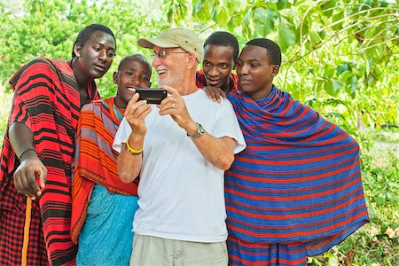 Tourist Showing Photo on Cell Phone to Group of Masai Men Stock Photo - Rights-Managed, Code: 700-03865405