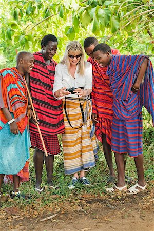 Female Tourist with Group of Masai Men Stock Photo - Rights-Managed, Code: 700-03865403