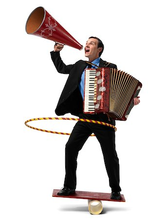 Businessman on Rocker Board Playing Accordian, Using Hula Hoop, and Yelling into Megaphone Stock Photo - Rights-Managed, Code: 700-03891174