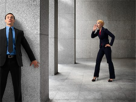 Businessman Hiding from Businesswoman Stock Photo - Rights-Managed, Code: 700-03891179