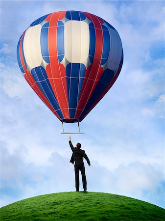 Businessman Reaching for Hot Air Balloon Stock Photo - Rights-Managed, Code: 700-03891170