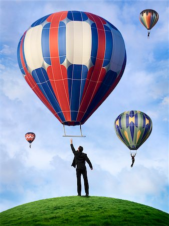 Business People Hanging On to Hot Air Balloons Stock Photo - Rights-Managed, Code: 700-03891171
