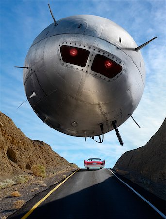 spaceship - UFO Hovering Over Car on Highway Stock Photo - Rights-Managed, Code: 700-03891189