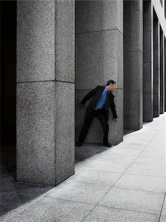people in panic - Businessman Peeking Around Column Stock Photo - Rights-Managed, Code: 700-03891182