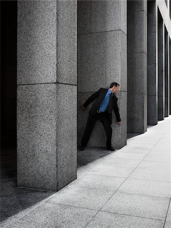 people in panic - Businessman Peeking Around Column Stock Photo - Rights-Managed, Code: 700-03891182