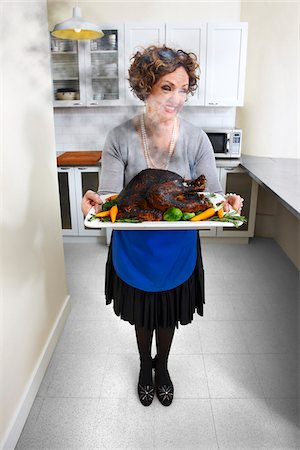 smelly - Woman Holding Burnt Turkey on Platter Stock Photo - Rights-Managed, Code: 700-03891287