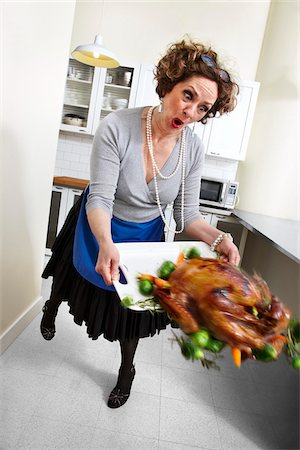 Woman Tripping on Dropping Turkey Platter Stock Photo - Rights-Managed, Code: 700-03891291