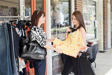 daughter middle-aged mother women young adults - Mother and Daughter Shopping Stock Photo - Rights-Managed, Code: 700-03891334