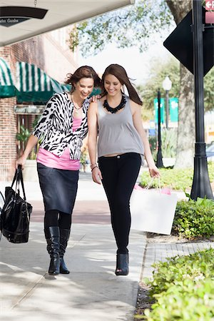 daughter middle-aged mother women young adults - Mother and Daughter Shopping Stock Photo - Rights-Managed, Code: 700-03891336
