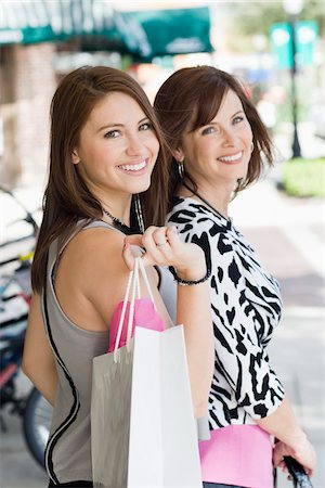 daughter middle-aged mother women young adults - Mother and Daughter Shopping Stock Photo - Rights-Managed, Code: 700-03891339