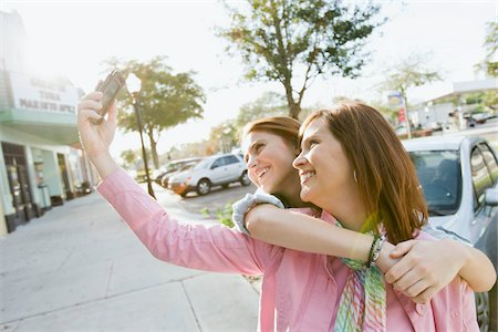 daughter middle-aged mother women young adults - Mother and Daughter Taking Self-Portrait Stock Photo - Rights-Managed, Code: 700-03891342