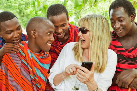 Woman Showing Cell Phone to Group of Masai Men Stock Photo - Rights-Managed, Code: 700-03893465