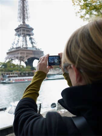 Woman Photographing Eiffel Tower, Paris, France Stock Photo - Rights-Managed, Code: 700-03907157