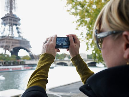 Woman Photographing Eiffel Tower, Paris, France Stock Photo - Rights-Managed, Code: 700-03907158
