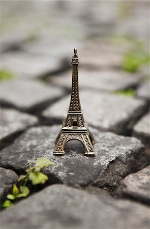 Miniature Eiffel Tower on Cobblestone Street Stock Photo - Rights-Managed, Code: 700-03907554