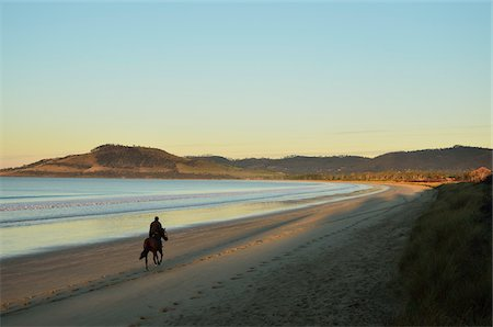 Man Riding Horse, Frederick Henry Bay, Seven Mile Beach, Tasmania, Australia Stock Photo - Rights-Managed, Code: 700-03907597