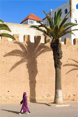 palm - Woman Walking by Ramparts of Old Town Essaouira, Morocco Stock Photo - Rights-Managed, Code: 700-03958179