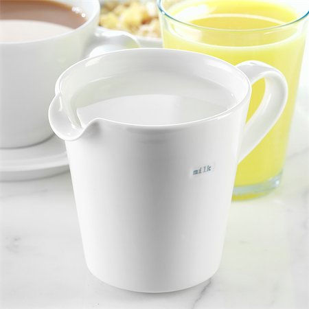 A Jug of Milk with Tea and Juice Stock Photo - Rights-Managed, Code: 824-06491548