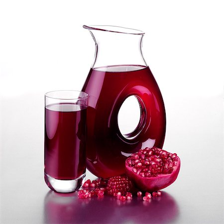 Jug of Pomegranate Juice with Halved Fruit and a Full Glass Stock Photo - Rights-Managed, Code: 824-06491563