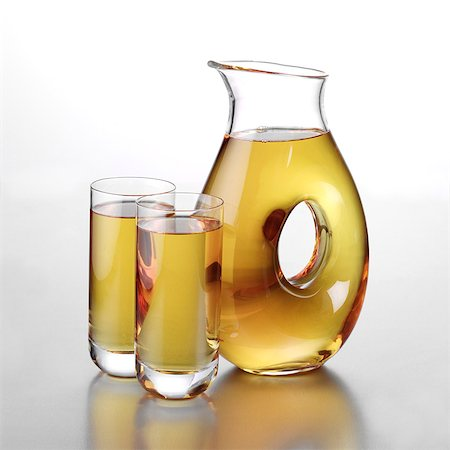 Jug of Apple Juice with Two Full Glasses Stock Photo - Rights-Managed, Code: 824-06491721