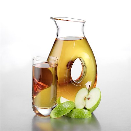 Jug of Apple Juice, Full Glass and Sliced Apple Stock Photo - Rights-Managed, Code: 824-06491723
