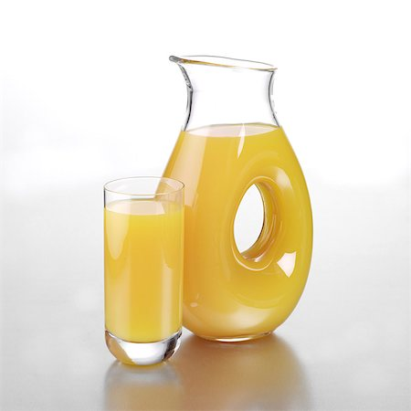 Jug of Mango and Orange Juice with a Full Glass Stock Photo - Rights-Managed, Code: 824-06491744