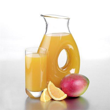 Jug of Mango and Orange Juice with a Full Glass Stock Photo - Rights-Managed, Code: 824-06491743