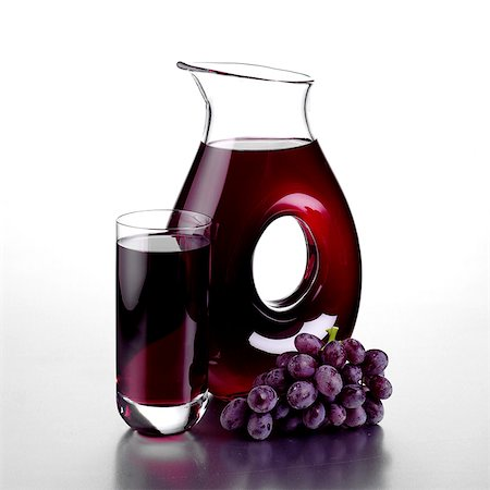 Jug of Grape Juice, a Full Glass and a Bunch of Grapes Stock Photo - Rights-Managed, Code: 824-06491762