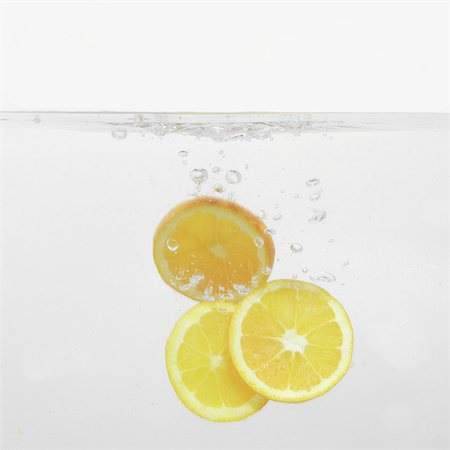 sweet   no people - Orange Slices splashing into water Stock Photo - Rights-Managed, Code: 824-06492107