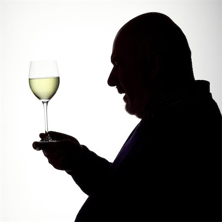 Silhouette Portrait of a man enjoying a glass of white wine Stock Photo - Rights-Managed, Code: 824-06492114