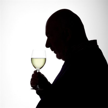 Silhouette Portrait of a man enjoying a glass of white wine Stock Photo - Rights-Managed, Code: 824-06492116