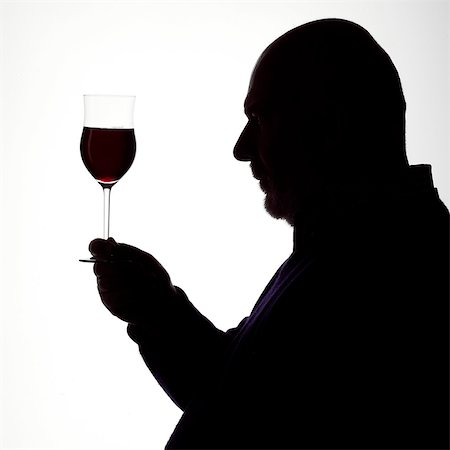 Silhouette Portrait of a Man enjoying a glass of red wine Stock Photo - Rights-Managed, Code: 824-06492117