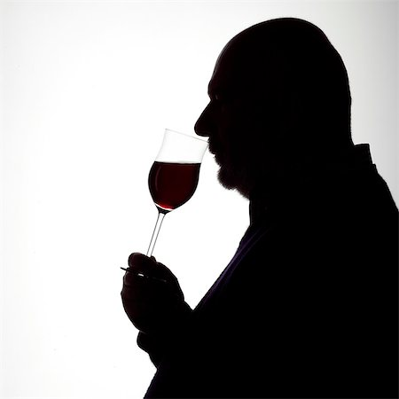 Silhouette Portrait of a Man enjoying a glass of red wine Stock Photo - Rights-Managed, Code: 824-06492120