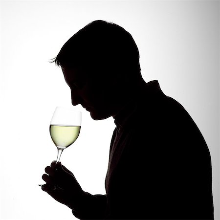 silhouette black and white - Silhouette portrait of a young man smelling a glass of white wine Stock Photo - Rights-Managed, Code: 824-06492138