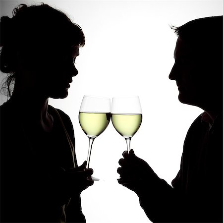 Silhouette portrait of a young couple enjoying a glass of white wine Stock Photo - Rights-Managed, Code: 824-06492144