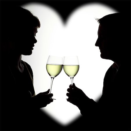 Silhouette of a couple enjoying white wine framed in a heart Stock Photo - Rights-Managed, Code: 824-06492145