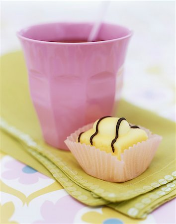 swirly - Lemon Fondant Fancy with a cup of juice Stock Photo - Rights-Managed, Code: 824-06492815