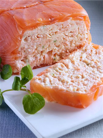 A whole salmon terrine with a slice in front Stock Photo - Rights-Managed, Code: 824-07194004