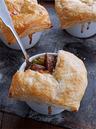 puff - Beef and Guiness pies on a baking sheet Stock Photo - Rights-Managed, Code: 824-07194007