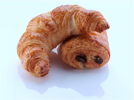 puff - A pain au chocolat and croissant on a white background Stock Photo - Rights-Managed, Code: 824-07194065