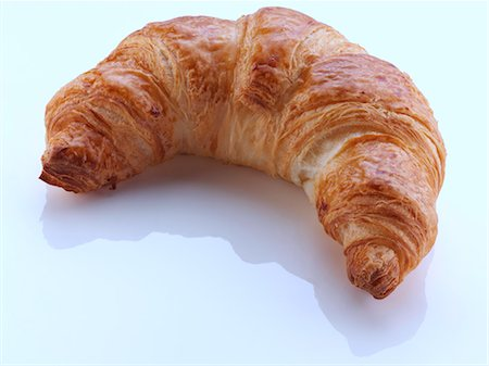 french (places and things) - A croissant on a white background Stock Photo - Rights-Managed, Code: 824-07194066