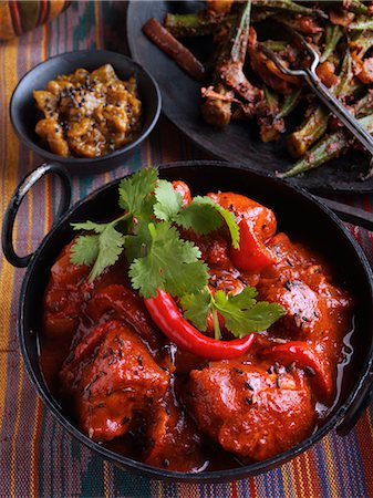 spicy - Chicken vindaloo Indian hot curry okra and aubergine chutney Stock Photo - Rights-Managed, Code: 824-07194101