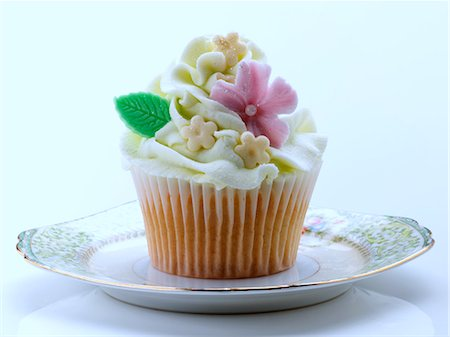 self indulgence - Flower iced cupcake Stock Photo - Rights-Managed, Code: 824-07194209
