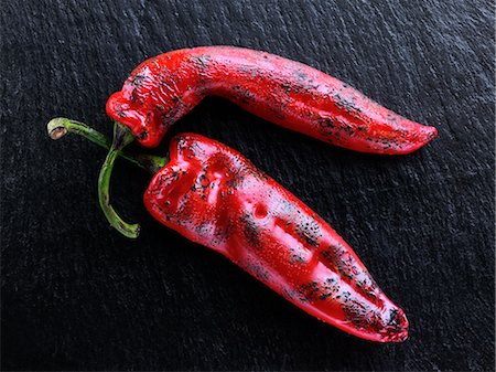 slate - Flamed red sweet point peppers Stock Photo - Rights-Managed, Code: 824-07194228