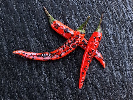 slate - Flamed red chili peppers chillies Stock Photo - Rights-Managed, Code: 824-07194232