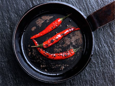 slate - Flamed red chili peppers chillies Stock Photo - Rights-Managed, Code: 824-07194233