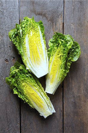 Little Gem Lettuce On Wooden Background Stock Photo - Rights-Managed, Code: 824-07193222